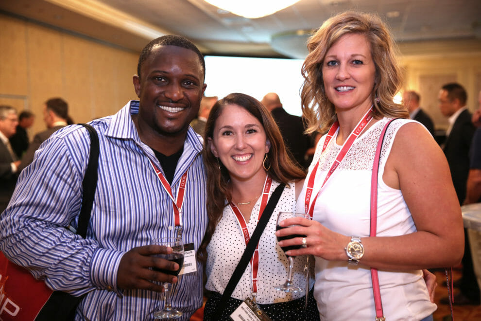 Conference Photography of attendees at networking mixer for AMP Clinical. Photography by Proimagesphoto