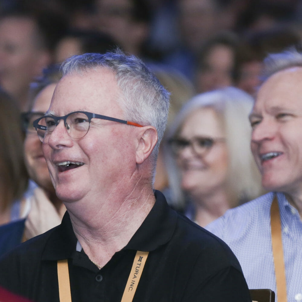 Convention and Conference Photography of Males laughing interacting at General Session Las Vegas