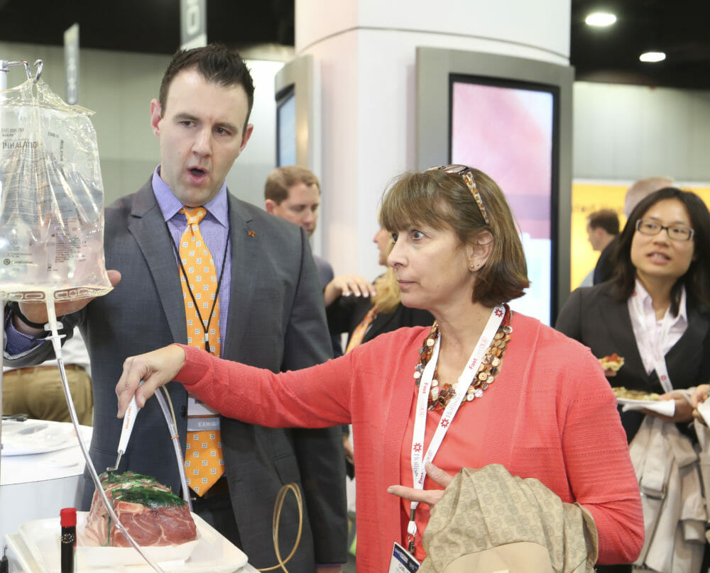 Healthcare Tradeshow Photography of attendee engaging in exhibitor booth