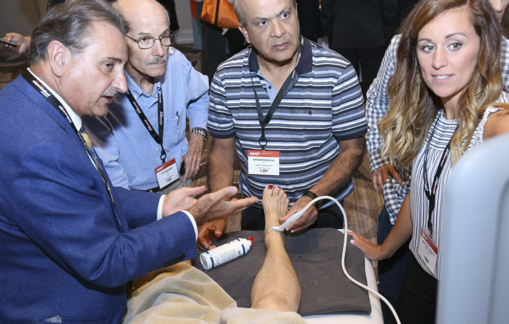 Healthcare and Medical Photography of Doctor training attendees on live patient | @proimagesphoto.com