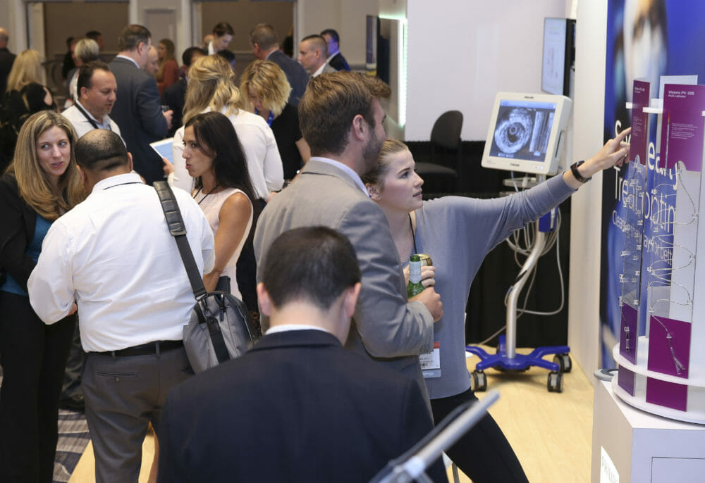 Attendees at Medical Convention in exhibitor area