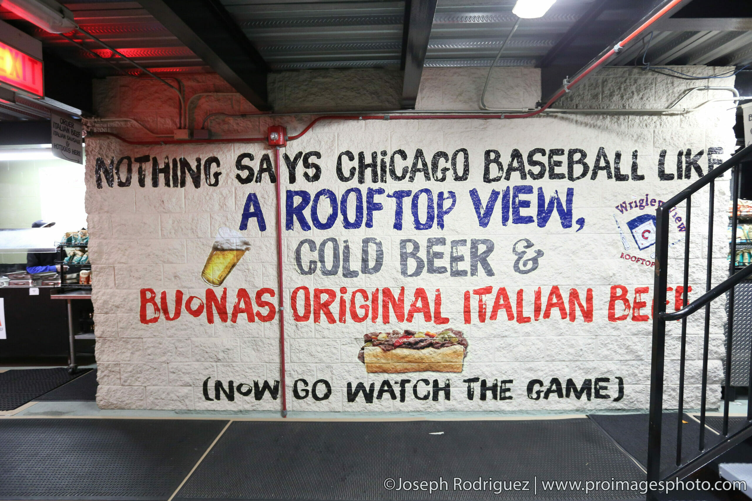 Sign inside a rooftop venue that allows people to see the Chicago Cubs