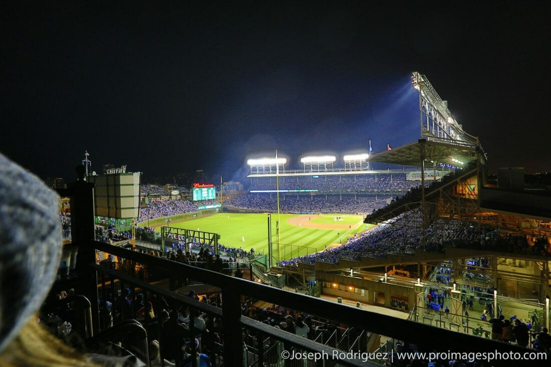Wrigley Field at night from the stands of a Rooftop viewing venue