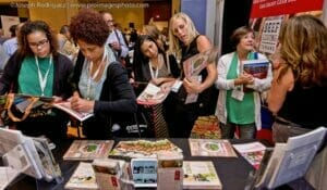 Convention Photography services by proimagesphoto.com of Attendees engaging at a tradeshow booth at the Marriott Rivercenter