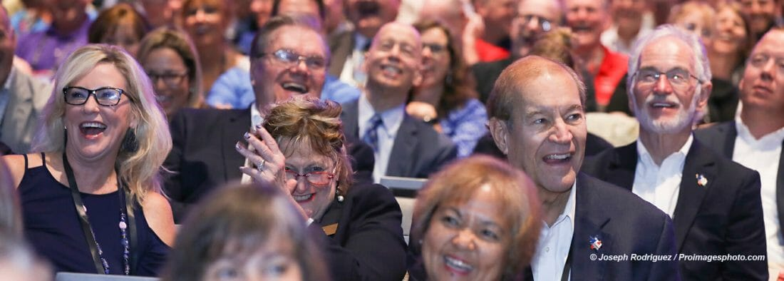 Orlando Convention Photography services showing attendees in a General Session enjoying keynote speaker.