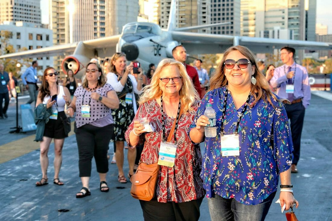 Female attendees at event on the USS Midway in San Diego