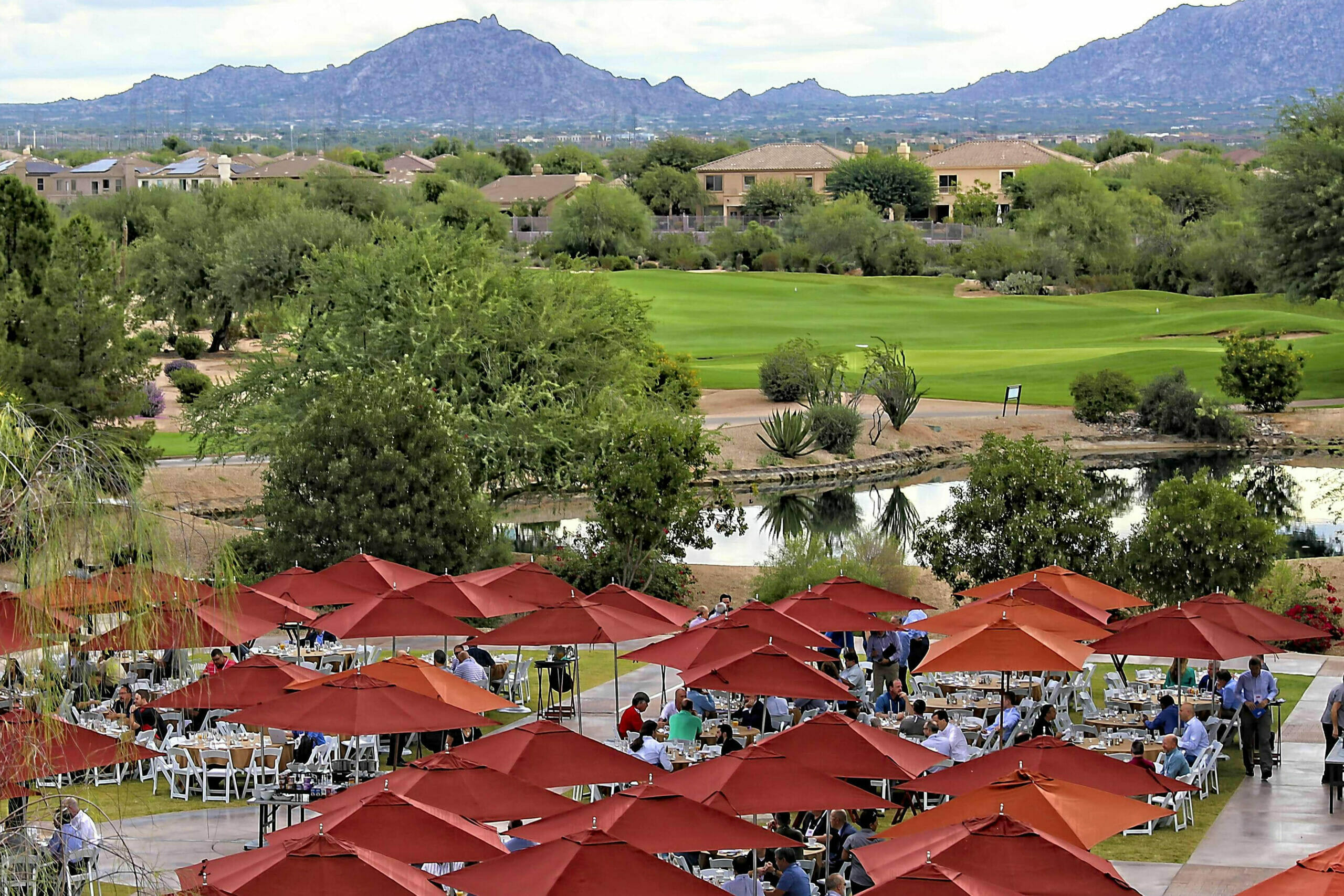 View of attendees having morning breakfast on the outside lawn of the JW Marriott Desert Ridge Resort
