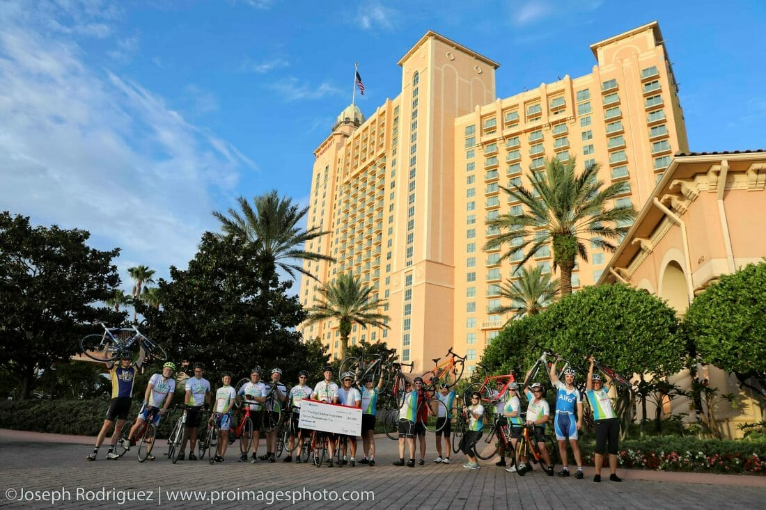 Convention Photography of meeting attendees on bikes in front of the JW Marriott Grande Lakes