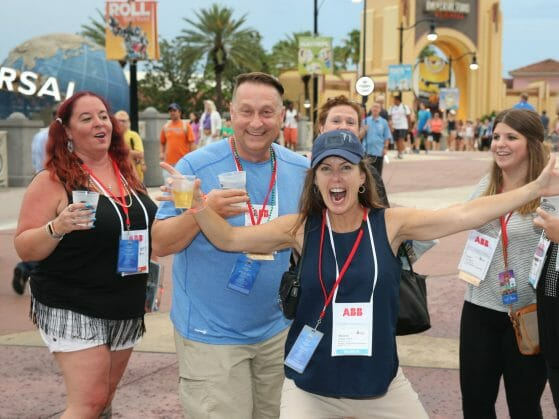 Orlando Event Photography of adults excited to be at Universal Studios The place for Conventions and Meetings