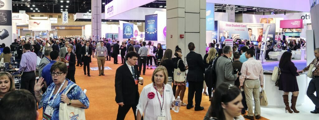 Convention, Tradeshow and Exhibitor Photography of attendees near and in Siemens Hearing Booth
