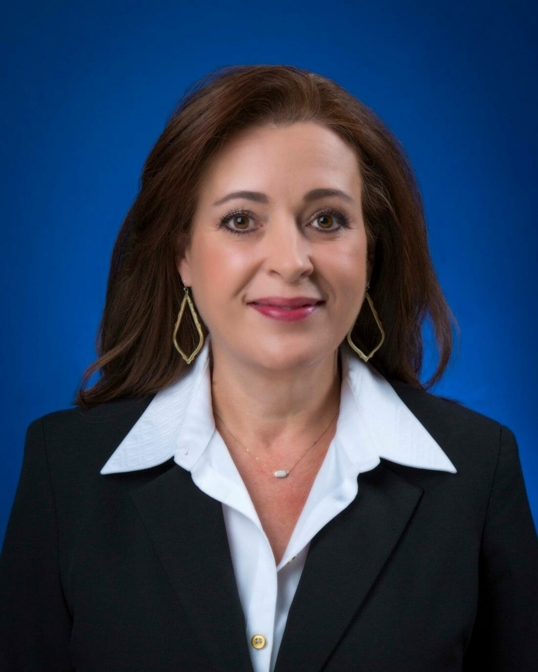 Corporate Business headshot of woman against blue background