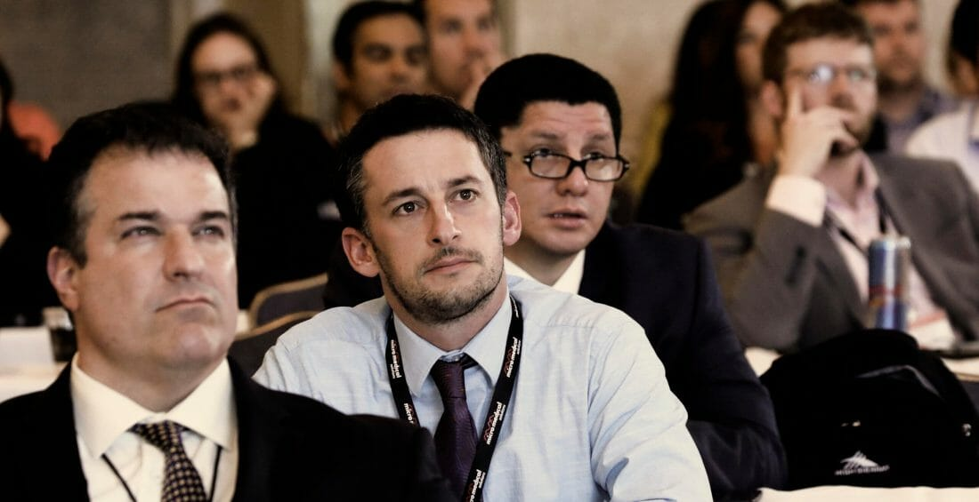 Covention Photography of males looking intently at the speaker during a conference.