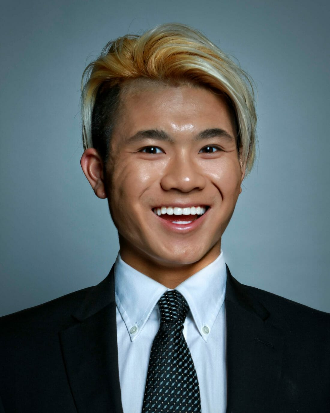 Young Asian Male getting a Professional headshot taken.