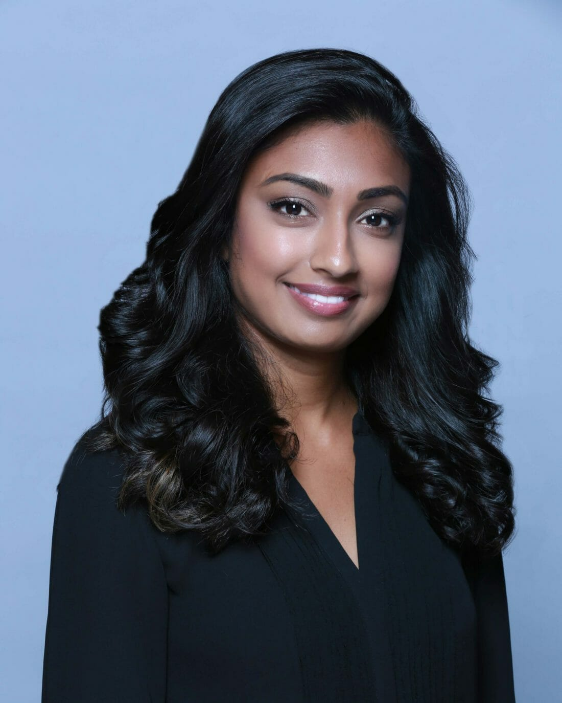 headshot photography of Indian Woman in black blouse