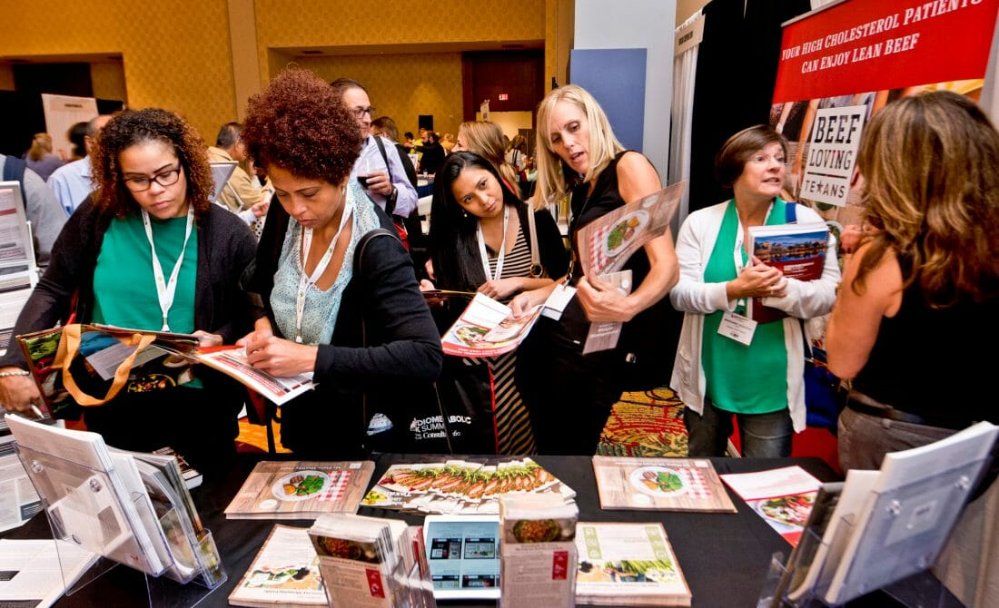 Houston Convention and Tradeshow Photography of attendees looking at exhibitor material