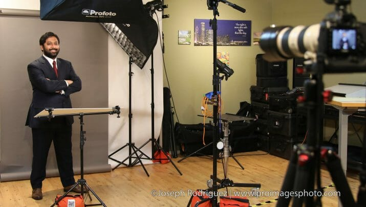 Headshot Photography studio setup using profoto lights and canon camera with male subject standing